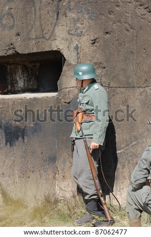 KIEV, UKRAINE -SEPT 18 : A member of Red Star history club wears historical German uniform during historical reenactment of WWII, September 18, 2011 in Kiev, Ukraine