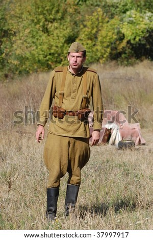 KIEV, UKRAINE - SEPT 19, : Member of a history club wear historical Soviet uniforms as he participates in a WWII reenactment.Battle for Kiev in 1943. September 19 , 2009 in Kiev, Ukraine