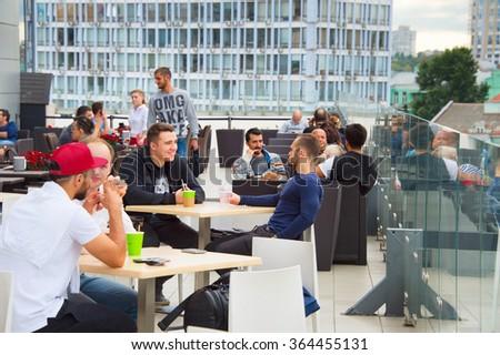 KIEV, UKRAINE - SEPT 21, 2015: People at rooftop restaurant in Kiev. Kiev is the capital and business centre of Ukraine. - stock photo