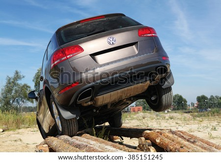 KIEV, UKRAINE - SEPTEMBER 11: An unidentified competitor participates in Volkswagen test drive on September 11, 2010 in Kiev, Ukraine. - stock photo