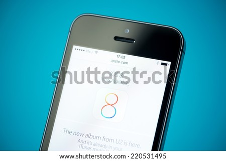 Kiev, Ukraine - September 24, 2014: Close-up shot of brand new Apple iPhone 5S showing apple.com website on a screen, featured new iOS8 operation system available for download. - stock photo
