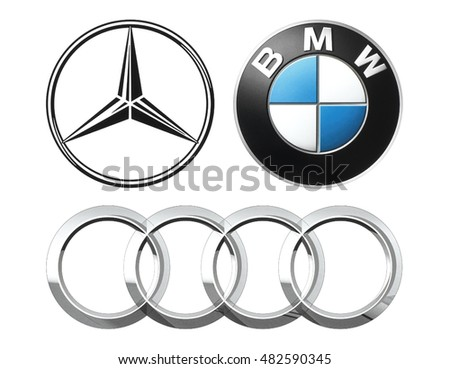 Kiev, Ukraine - September 12, 2016: Collection of popular German car logos printed on white paper: Mercedes, BMW and Audi.