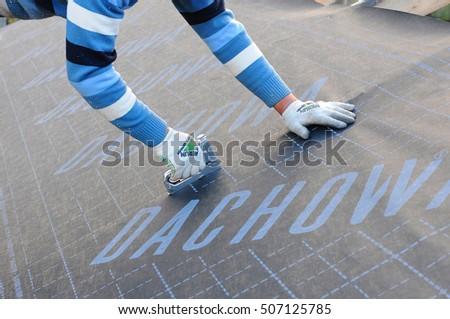 KIEV, UKRAINE   SEPTEMBER 28, 2016: Construction Worker Installs Vapor  Barrier On The