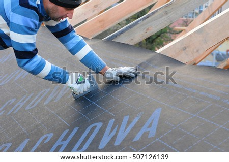 Exceptional KIEV, UKRAINE   SEPTEMBER 28, 2016: Construction Worker Installs Vapor  Barrier On The