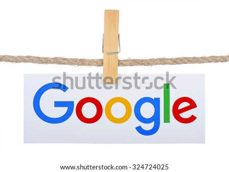 KIEV, UKRAINE - SEPTEMBER 16, 2015: Logo largest Internet search engine Google hanging on the clothesline isolated on white background.Google it is the largest Internet search engine, owned of Google - stock photo