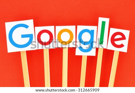 KIEV, UKRAINE - SEPTEMBER 02, 2015:New Google logotype printed on paper, cut and pasted on wooden sticks.Google is USA multinational corporation specializing in Internet-related services.