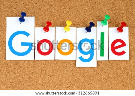 KIEV, UKRAINE - SEPTEMBER 02, 2015:New Google logotype printed on paper, cut and pinned on cork bulletin board.Google is USA multinational corporation specializing in Internet-related services - stock photo