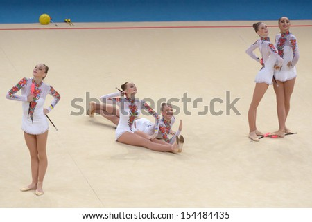 KIEV, UKRAINE - SEPTEMBER 1: Team Ukraine performs the routing with clubs during the 32nd Rhythmic Gymnastics World Championships in Kiev, Ukraine on September 1, 2013 - stock photo