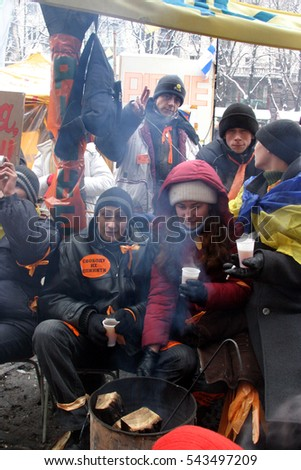 Kiev, Ukraine - 20.12.2004. The Orange Revolution in Kiev. Tents and Protestants on Khreshchatyk Street and Independence Square