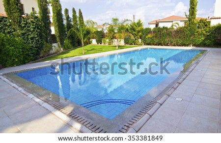 KIFISSIA GREECE, DECEMBER 20 2015: house garden with swimming pool, expensive real estate concept. Editorial use only
