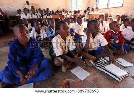 KIGOMA - TANZANIA - JULY 9, 2015: Unidentified students in primary school on July 9, 2015 in Kigoma, Tanzania. Tanzania has still an alarming drop-out rate of students in primary school - stock photo