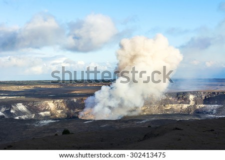 Kilauea volcano exploding after an earthquake spills rocks into the molten lava of the active vent within the caldera.V - stock photo