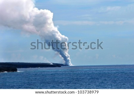 Kilauea Volcanoe dumps new lava into the ocean and onto the edge of the Big Island of Hawaii. - stock photo