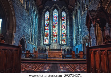 KILKENNY, IRELAND - NOVEMBER 22, 2014: Interior of St Canice's Cathedral which dates from 13th century. Unique stained-glass windows inside a well preserved irish monument - stock photo