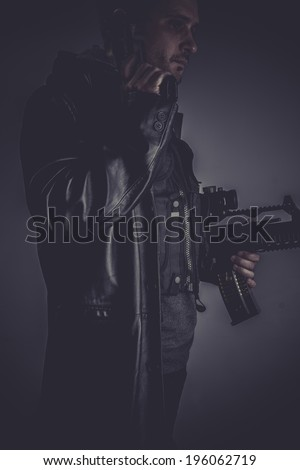 Killer, gangster with gun and pistol - stock photo