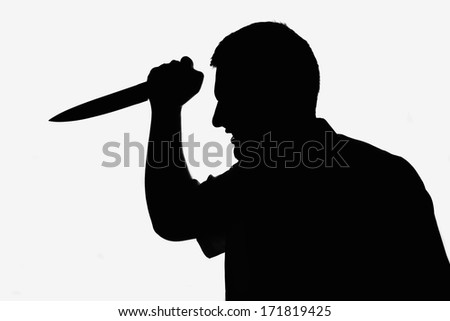Killer man holding knife in hand. Silhouette picture