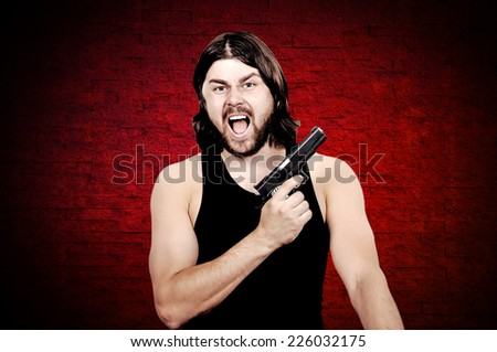 Killer with gun over grunge background - stock photo
