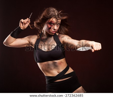 Killer woman with knife. Posing in studio.  - stock photo