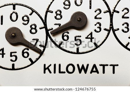 Kilowatt hour electric meter register dials and pointers - stock photo