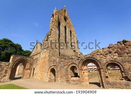 Kilwinning Abbey, North Ayrshire, Scotland - July 2013: The ruins of Kilwinning Abbey against a blue sky - stock photo