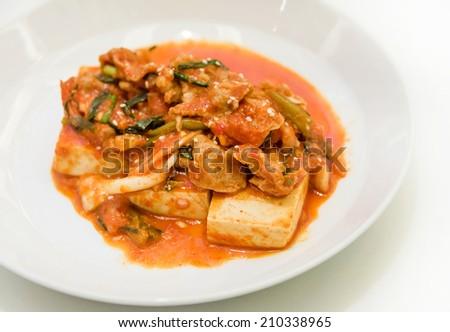 Kimchi and tofu on white background. It's creative Korean cuisine. - stock photo