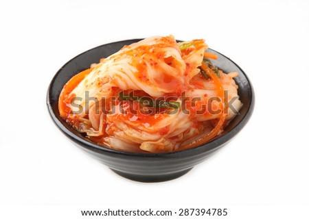 Kimchi (Korean food) close up on white background - stock photo