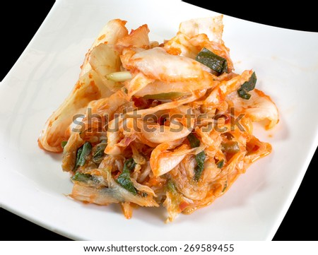 Kimchi korean food in white plate, on black background - stock photo