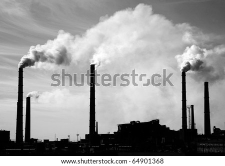 Kind of factory with smoking pipes - stock photo