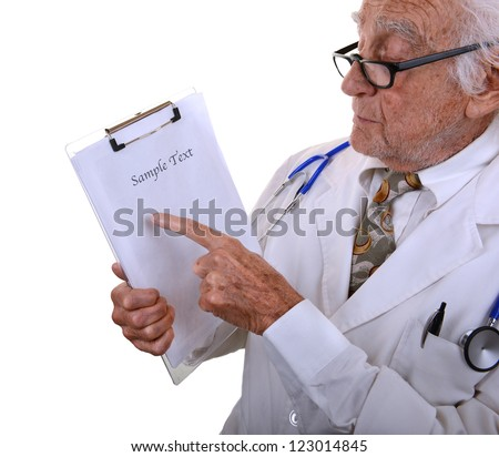 Kind old doctor wearing a white lab coat pointing at a blank chart isolated on white - stock photo