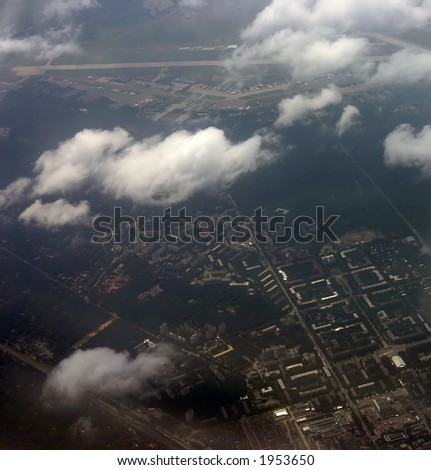 kind on a city from an airplane from the height of bird flight - stock photo
