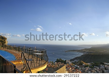 Kind on a coastal line of Sicily from height of a terrace of hotel - stock photo