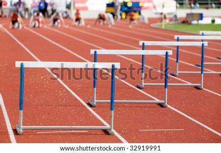 Kind on barriers at competitions on run - stock photo