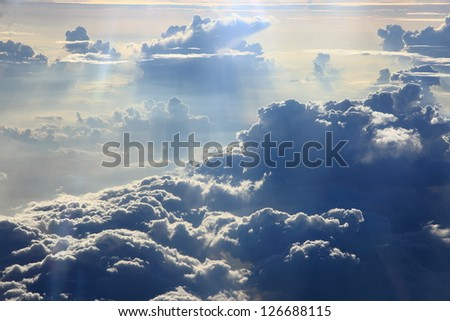 kind on clouds on a background a firmament from an airplane - stock photo