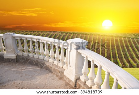 Kind on mountain from a stone balcony - stock photo