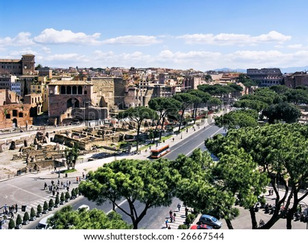 Kind on ruins of ancient Rome and the Collosseo - stock photo