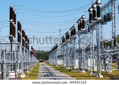 Kind on substation of a high voltage against the blue sky - stock photo