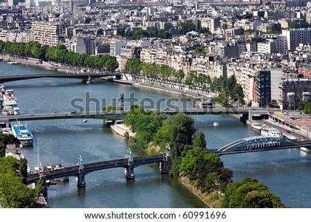 Kind on the river Seine with three bridges, Paris, France - stock photo