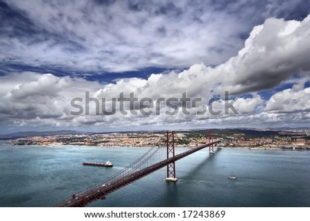 Kind on the river Tagus and the bridge of a name on April 25, Lisbon, Portugal - stock photo
