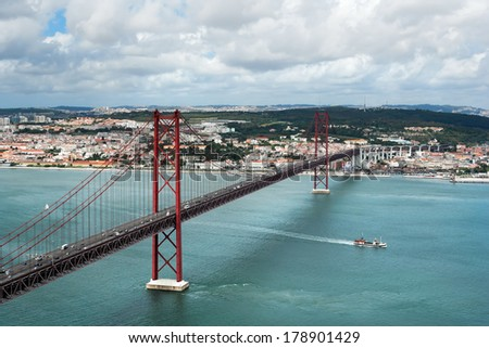 Kind on the river Tagus and the bridge of a name on April, 25, Lisbon, Portugal - stock photo