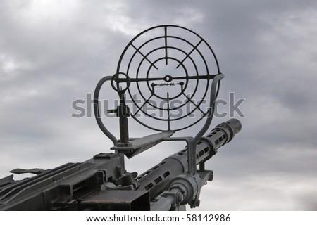 Kind on the sky through a machine gun sight - stock photo