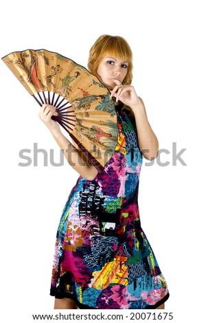 Kind, pretty girl with gentle smile, wearing colorful dress.