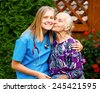 Kind young doctor being admired and loved by elderly patient. - stock photo
