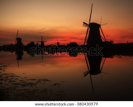 Kinderdijk, Holland: traditional windmills at sunset - stock photo
