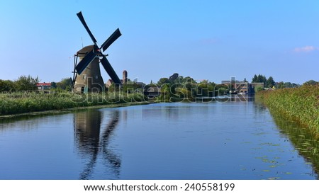 KINDERDIJK - SEPTEMBER 17: A collection of authentic historic windmills in Kinderdijk, a UNESCO World Heritage site, taken on September 15, 2014 in Kinderdijk, Netherlands
