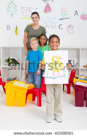 kindergarten boy in classroom - stock photo