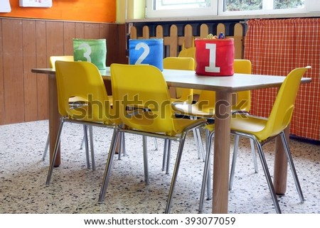 kindergarten class with the yellow chairs and small tables and boxes for toys