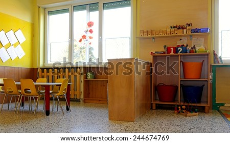 kindergarten classroom with yellow chairs and table - stock photo