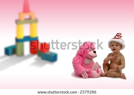 kindergarten - kindergarten - baby plays with a toy - stock photo