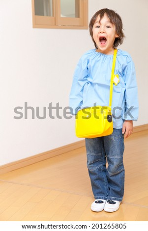 Kindergartener laughing from ear to ear