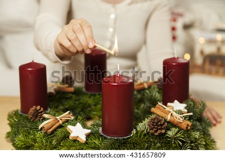 Kindle first candle on the first Advent - stock photo